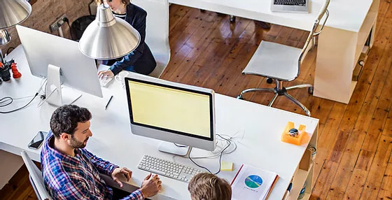 People working at their desks in an office